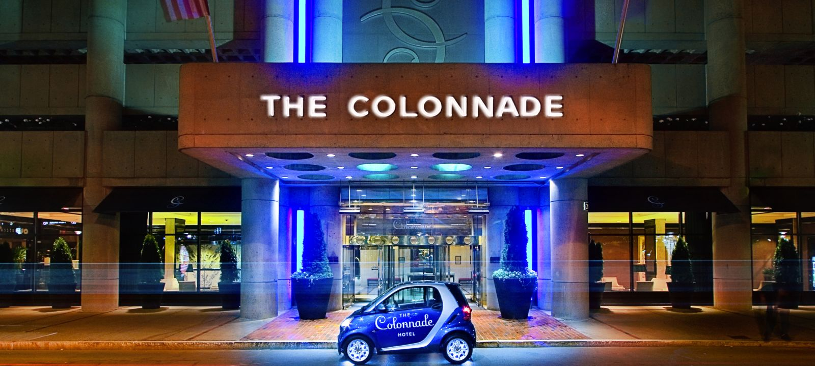 The Colonnade Hotel Entrance with smart car in front at night