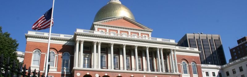 A Large White Building With Massachusetts State House In The Background